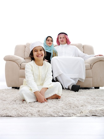 middle eastern families: Happy Arabic family at home Stock Photo