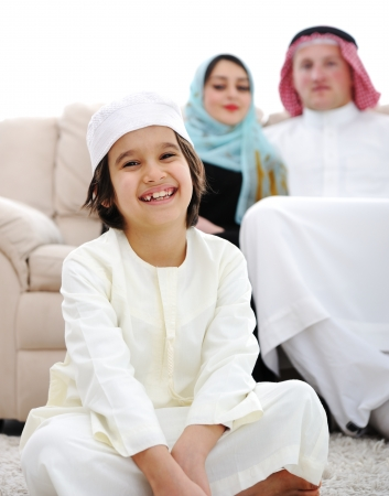 arab: Happy Arabic family at home Stock Photo