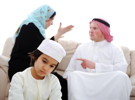 women fighting: Arabic couple fighting and child suffering Stock Photo