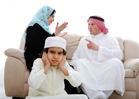Arabic couple fighting and child suffering photo