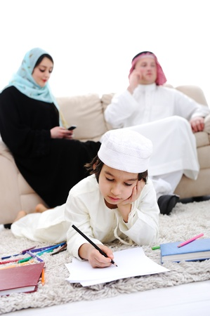 Happy kid working on homework at home with his family Stock Photo - 16159946
