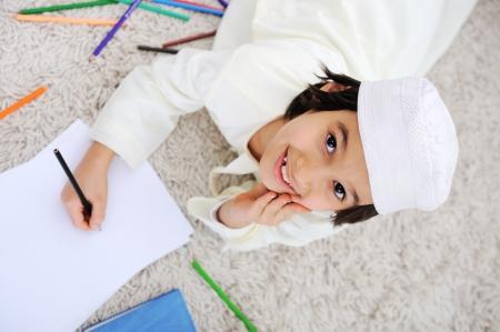 Arabic little boy doing homework at home photo