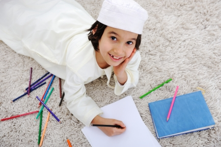 learning arabic: Arabic little boy doing homework at home