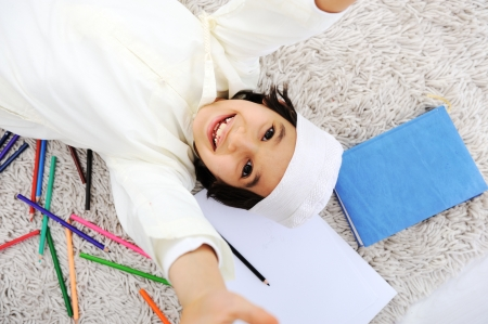 Arabic little boy doing homework at home photo