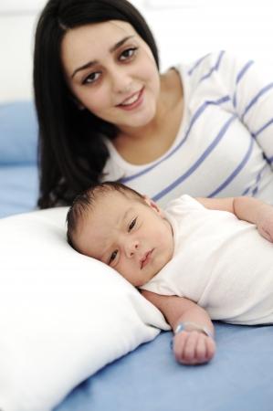 muslim baby girl: Happy mother with newborn baby