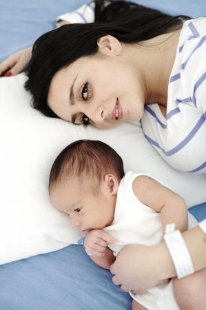 Happy mother with newborn baby photo