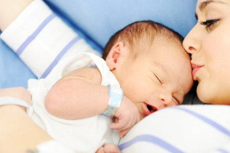 Woman holding her 2 days old newborn baby Stock Photo - 16154524