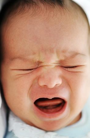 mixed race baby: Newborn baby crying