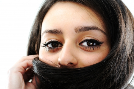 indian mask: Beautiful brunette girl face with hair mask Stock Photo