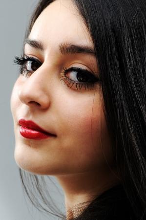 lipgloss: Beautiful brunette girl face