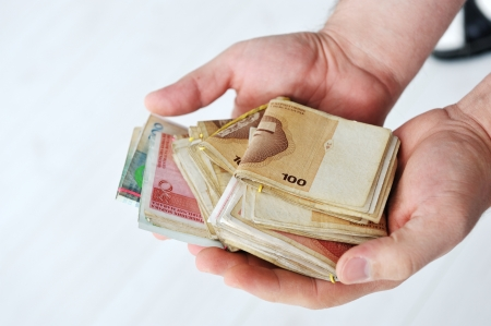 putting money in pocket: Man putting money to pocket Stock Photo