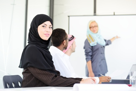 arab people: Arabic middle eastern woman having a business presentation with copy space board Stock Photo