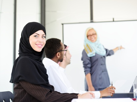 Arabic middle eastern woman having a business presentation with copy space board photo