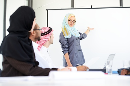middle eastern woman: Arabic middle eastern woman having a business presentation with copy space board Stock Photo