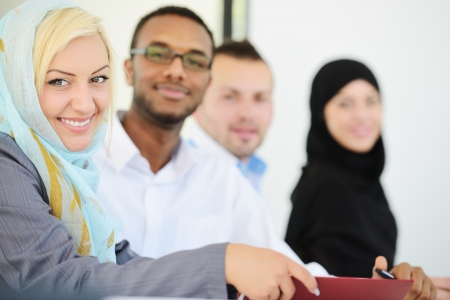middle eastern ethnicity: Arabic business group sitting in a row line