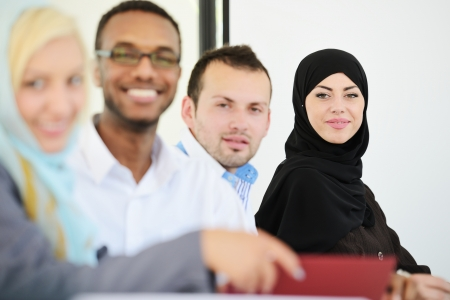 arab: Arabic people having a business meeting Stock Photo