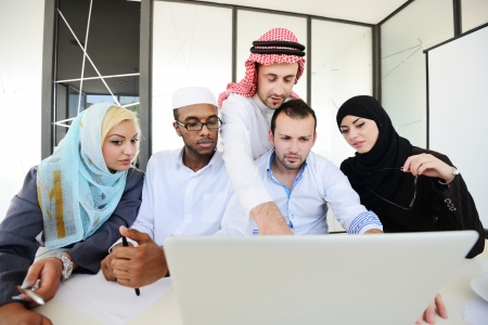 arab adult: Group of multi ethnic business people at work