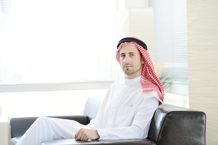 Arabic adult sitting in office photo