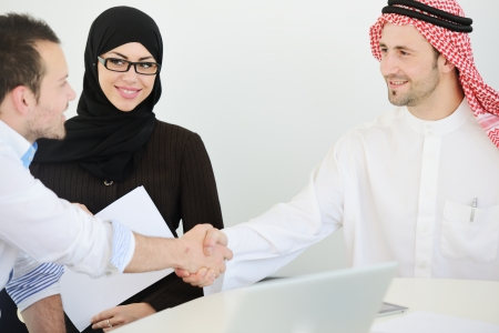 arab people: Group of multi ethnic business people dealing a contract and hand shaking