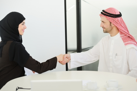 Group of multi ethnic business people dealing a contract and hand shaking photo