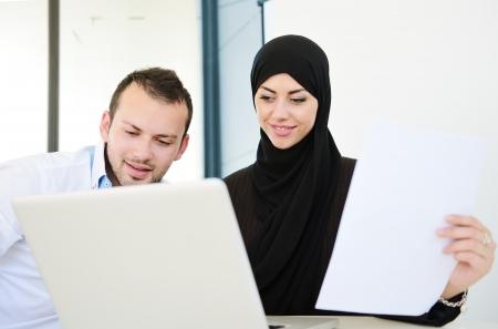 arab men: Group of multi ethnic business people at work