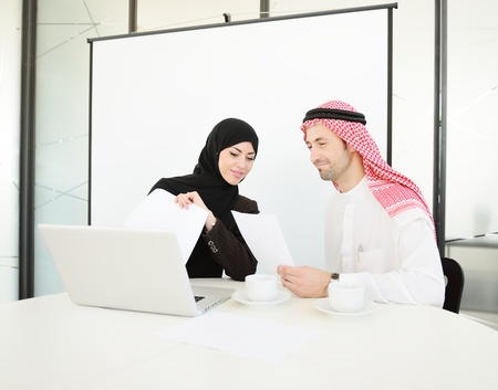 arab girl: Group of multi ethnic business people at work