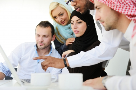 Arabic people having a business meeting photo