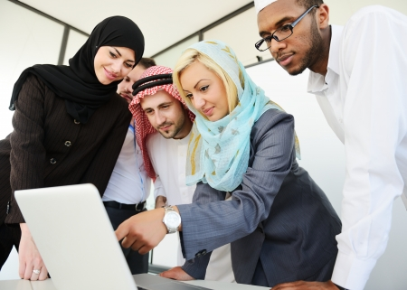 middle eastern ethnicity: Arabic people having a business meeting Stock Photo