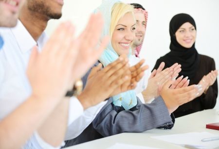 Group of multi ethnic business people applauding during presentation photo