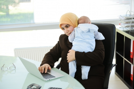 arabic woman: Muslim Arabic mother businesswoman with baby at office
