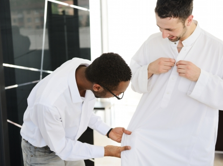 Group of multi ethnic business people at work wearing arabic clothes photo