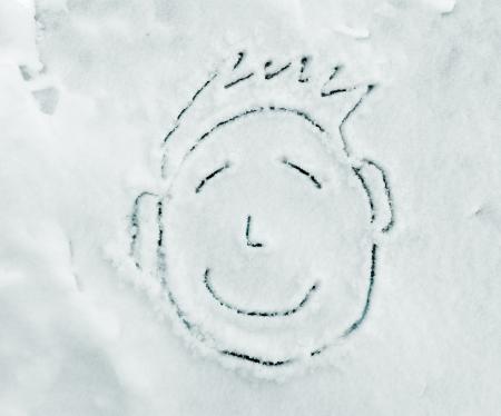 Smiley face portrait on snow photo