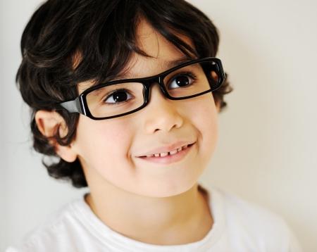 Child portrait with eye glasses photo
