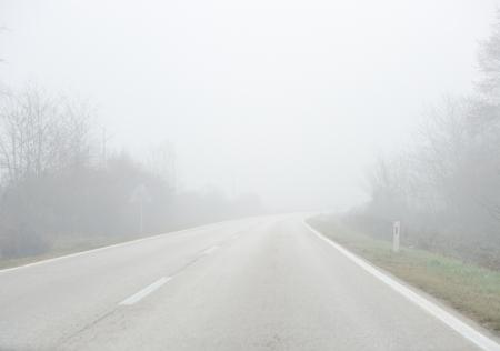 Road in fog photo