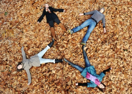 fall time: Group of friends in park together