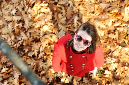 Young girl in autumn park photo