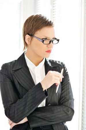 Young business woman at office Stock Photo - 18476049