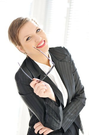 Young happy business woman at office photo