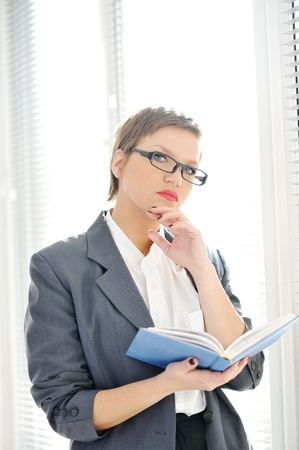 Young business woman at office photo