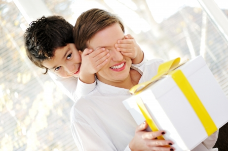 Son with surprise for mother Stock Photo