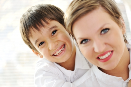 single parent: Family portrait of mother and son at home
