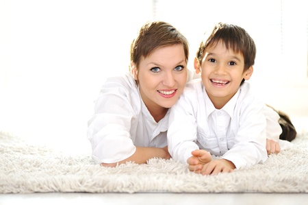 Family portrait of mother and son at home photo