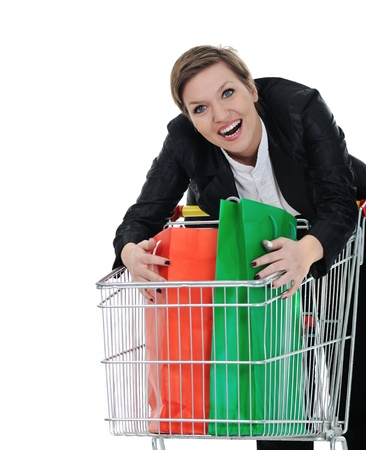 Young woman with shopping cart isolated Stock Photo - 18475614