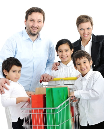 Happy family with a shopping cart photo