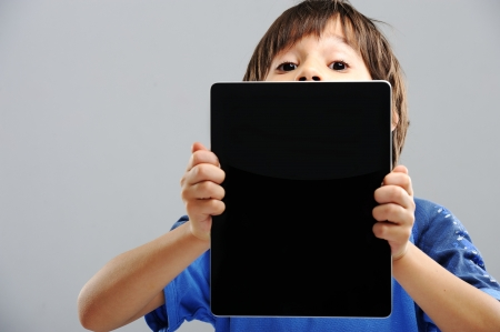 Cute kid with Tablet Stock Photo - 18475318