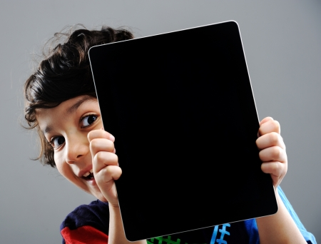 Cute kid with Tablet photo