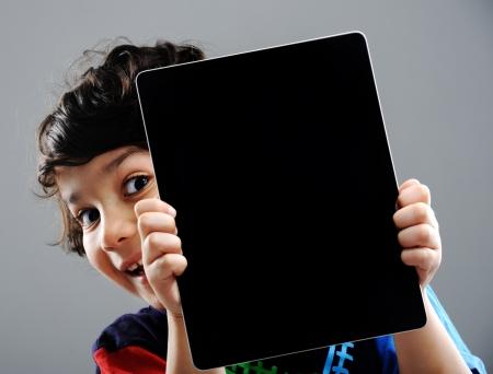 arabic boy: Cute kid with Tablet