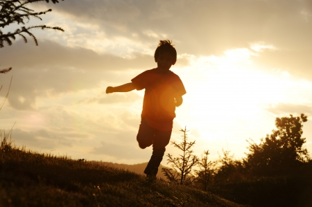 children running: Kid running on meadow silhouette