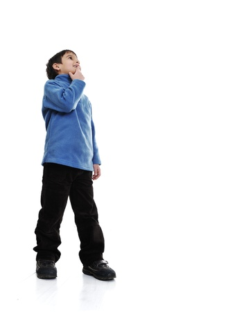 Little boy isolated on white looking up Stock Photo