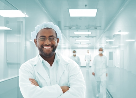 Working people with white uniforms in modern facility photo